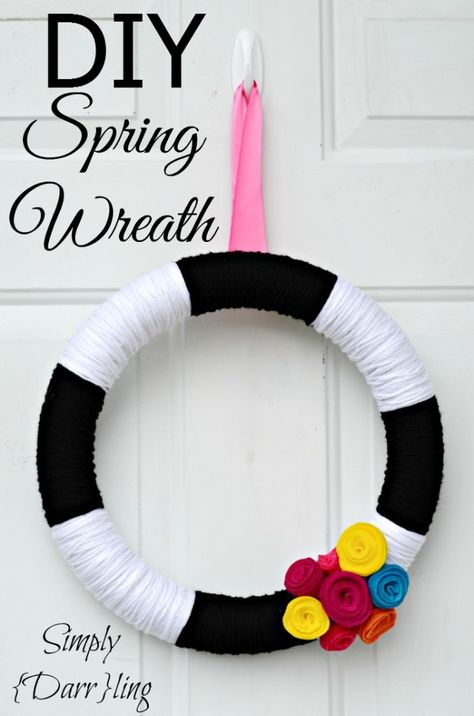 DIY Spring Yarn Wreath - a fun way to spruce up your front door for spring.