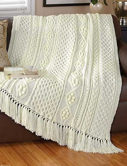 Knitting Pattern for Dreams of Ireland Afghan - Prize-winning afghan pattern features panels of honeycomb cables and diamond cables that are sewn together. One of the patterns in Classic Afghans, available as an ebook or paperback.
