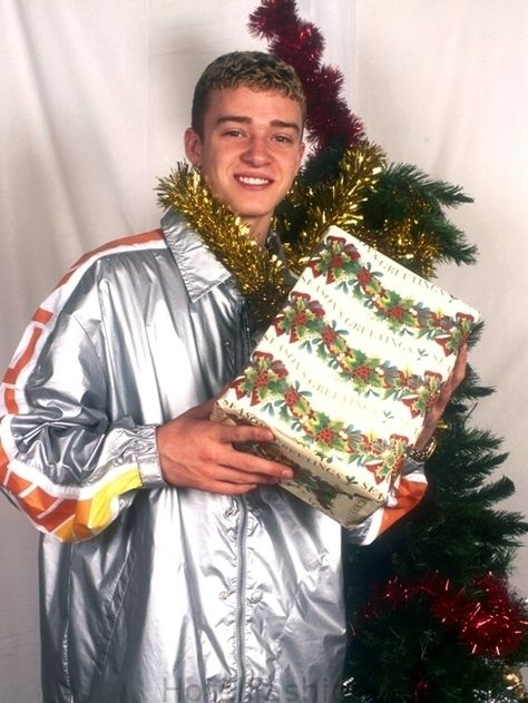 Justin Timberlake was nearly strangled by tinsel on this photo shoot. | 18 Extremely Awkward Celebrity Christmas Photoshoots
