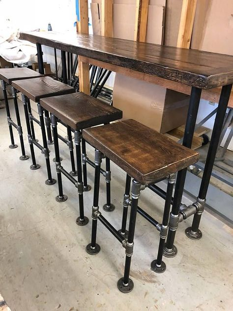 Reclaimed wood console table top , bar top , sofa table. Stools available fro sale but not included This includes drink rail. This style has a dark brown border edge. We can make solid color finish as well. 18 x 72 2 reclaimed wood border edge Counter height industrial 1 1/4 pipe
