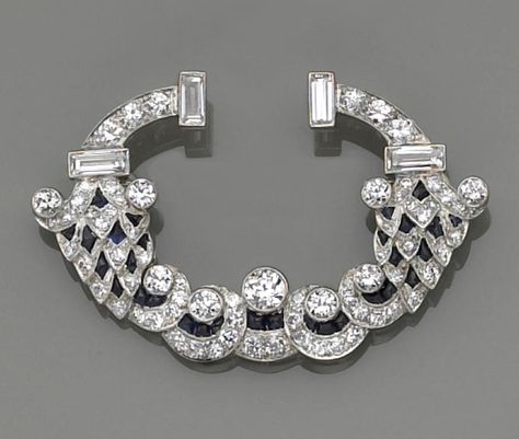 A late art deco diamond and synthetic sapphire brooch designed as European and baguette-cut diamond arches, to rolling cascades of European-cut diamonds, completed with calibré-cut synthetic sapphires; estimated total diamond weight: 4.00 carats; mounted in platinum.