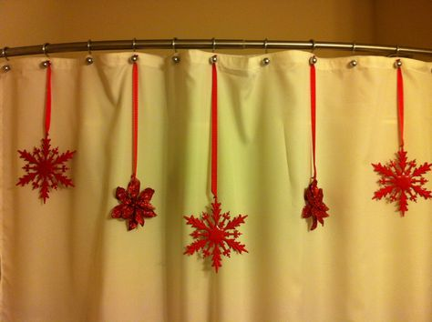 Dollar store ornaments on a shower curtain! Great way to decorate your bathroom for Christmas.