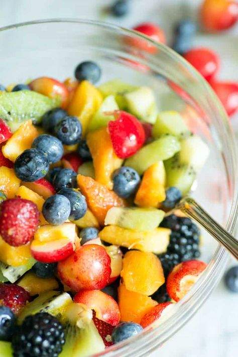 Peaches, blueberries and whatever fruit is in season make a perfect salad on a hot summer day. A honey lime dressing brightens up the flavors for an easy summer side dish. Cherries are a great addition, along with kiwi and strawberries. #butterandbaggage.com #fruitsalad #summersidedish #fruit