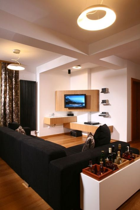 The Placement Of The Tv In The Corner Is Interesting Corner Tv Unit Apartment Design Corner Tv Cabinets