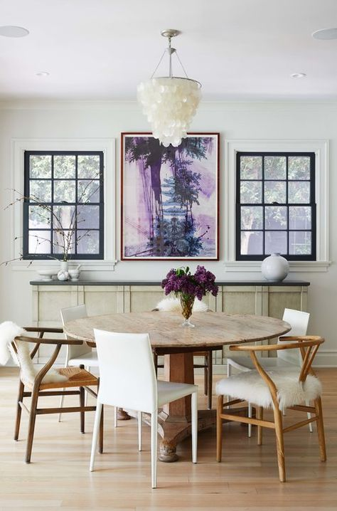 Round Dining Table Mis Matched Dining Chairs Purple Accents In