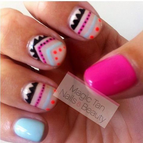 Aztec nail art on neutral base with blue, pink, and neon orange details