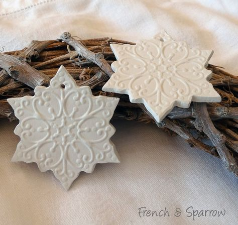 Beautiful handmade Snowflake Clay Tags. Should be quite easy to do in polymer clay or salt dough. Beautiful DIY christmas ornaments.