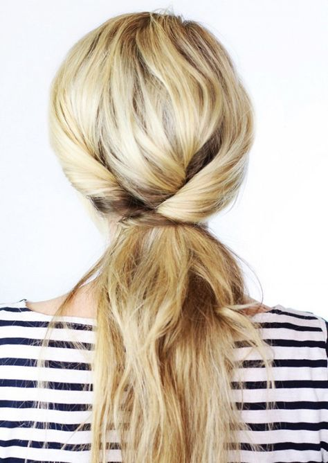 This tri-twisted pony is literally just three sections of hair twisted down into a low ponytail secured with bobby pins. Looks a lot trickier than that, right? Don't believe us? Check out...