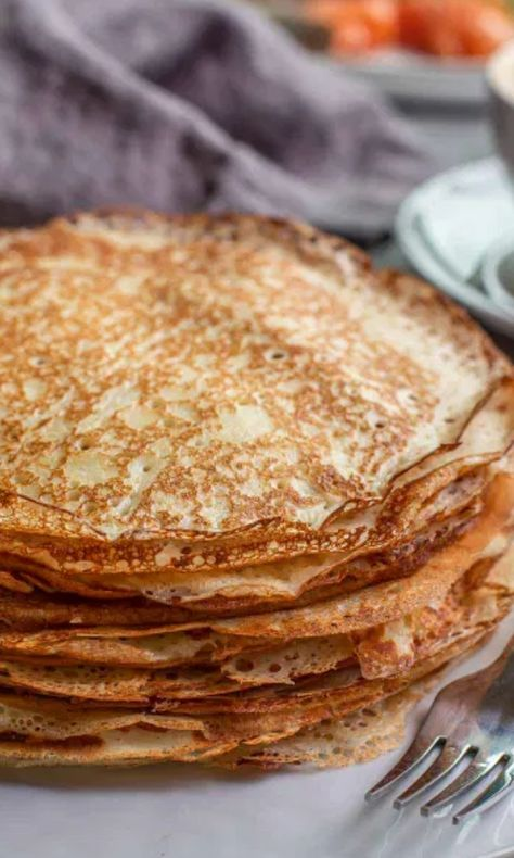 Blinis are similar to a crepe that is thick, slightly chewy and has a gorgeous lacy appearance from the yeast in the batter. #Breakfast #Crepes #Dessert #Easyblinis #Russianblini