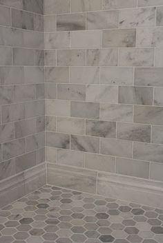 bathroom tile ideas. Love the round hex shape in floor with rectangle on wall  Bathroom Shower TilesBathroom 11 75 a Sheet Carrara Venato 3x3 Hexagon Marble Mosaic Tile Honed