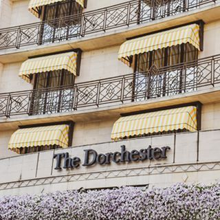 Yellow And White Striped Awning Welcomes You To The Dorchester The Dorchester Dorchester Collection
