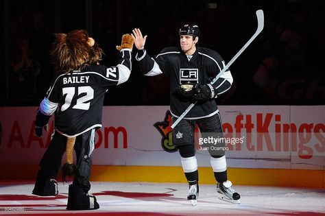 Milan Lucic #17 of the Los Angeles Kings gets a high five from Bailey after a win against the Detroit Red Wings on January 11, 2016 at Staples Center in Los Angeles, California.