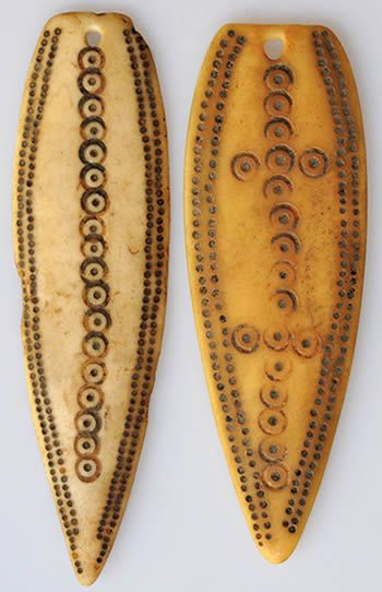 Africa | Two bone pendants from Ethiopia | Early 1900s
