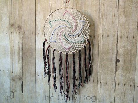 This dreamcatcher pattern takes a crochet doily to the next level. Think of this as mixed media for fiber artists. Beads are used to accent a basic crocheted st