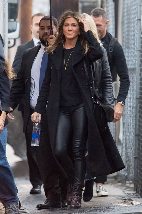 Jennifer Aniston capsule wardrobe: black coat with leather trousers in 2018
