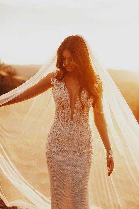 Lauren Rote Youash Wedding - Stunning #GLBride Lauren wowed in her glamorous long-sleeve #Bella wedding dress teamed with a long bridal veil.  Photo: @jordanvoth