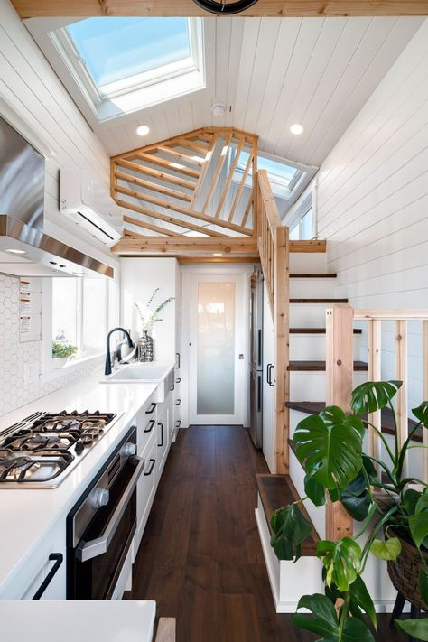 Mint Tiny House Company recently completed a new tiny house. The home is light-filled thanks to its generous glazing, which includes no less than five skylights, and has two bedrooms, plus a spacious bathroom with shower and full-size bathtub. Tyni House, Tiny House Loft, Best Tiny House, Modern Tiny House, Tiny House Plans, Tiny House Design, Tiny House On Wheels, Tiny Loft, Tiny House Bedroom