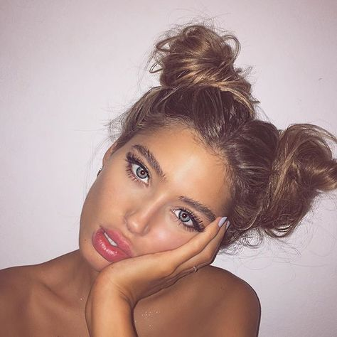 Pigtail buns instead of the traditional bun for the pool or beach days!