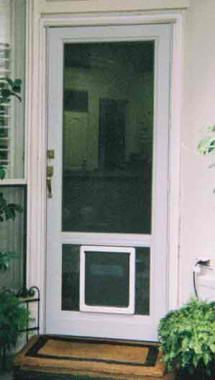 A Pet Door Installed In A Storm Door For Dogs Or Cats Great Solution For A Doggie Door Diy Doggie Door Diy Screen Door Custom Screen Doors