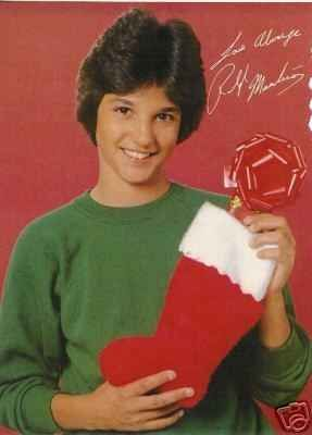 Ralph Macchio, aka The Karate Kid, holds a stocking with what appears to be a very disappointing gift inside.