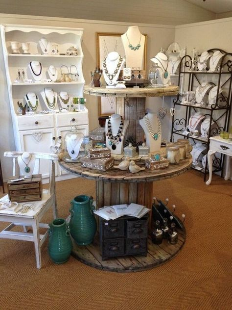 Love the round wood double stack tables! boutique displays i Boutique Decor, Boutique Store Displays, Boutique Jewelry Display, Boutique Ideas, Jewelry Store Displays, Display Ideas For Jewelry, Jewelry Shop, Jewelry Table Display, Boutique Stores