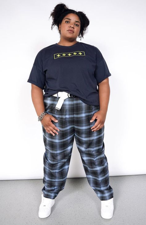 Elevate your look with the effortlessly refined style of plaid pants styled with crisp pleats at the front.