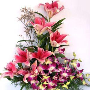 Basket Arrangement Of 4 Oriental Lilies 6 Orchids Oriental Lily Flowers Orchids