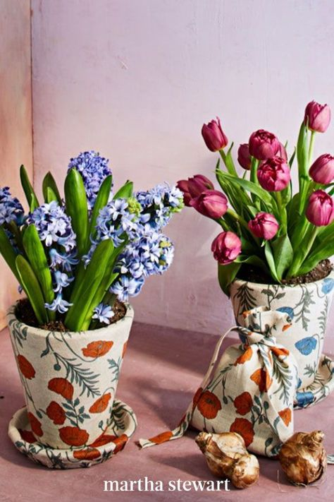 Floral-print linen can elevate a standard terra-cotta pot. To add fresh petals, simply slip a peak-season hyacinth or tulips (in their original vessel) inside. If you want to repot the blooms in the pretty container, leave the saucer fabric-free for watering. #marthastewart #crafts #diyideas #easycrafts #tutorials #hobby