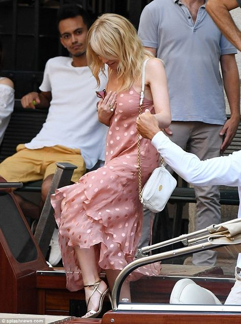 Kylie Minogue, 50, looks effortlessly chic in salmon pink summer dress