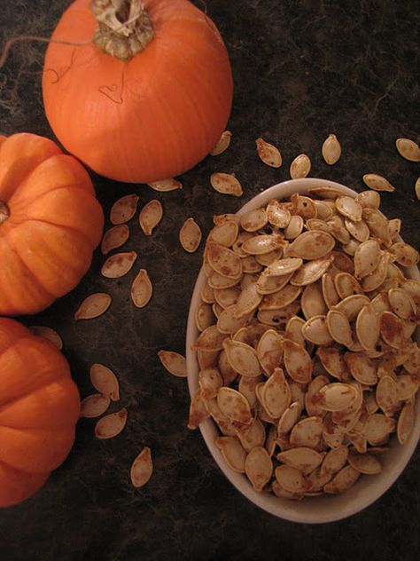 Baked pumpkin seeds is our autumn tradition! Clean seeds throughly by running warm water over them in a colander. When clean, pat with a paper towel to remove some of the water. Put seeds in a large bowl and mix with canola oil and salt. There should be a very light coating of oil and salt on each seed. Spread seeds on baking pan and bake until light to medium golden brown. Let cool and then enjoy!
