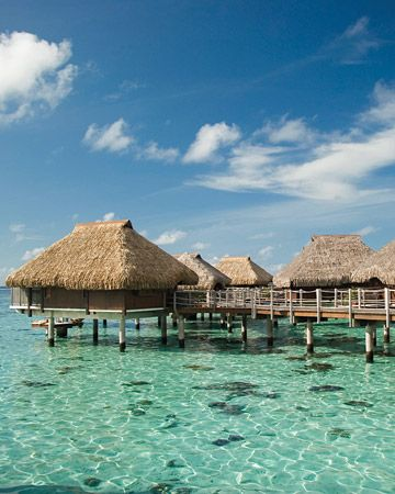 Bora Bora.... Always wanted to stay in one of these huts over the water!