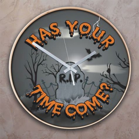"""A hilarious must have in the Halloween decor. This Halloween wall clock is titled, """"Has Your Time Come?"""" and features a spooky grave yard. Choose from 2 great styles. Both clocks are a generous 16 inch diameter for easy viewing."""