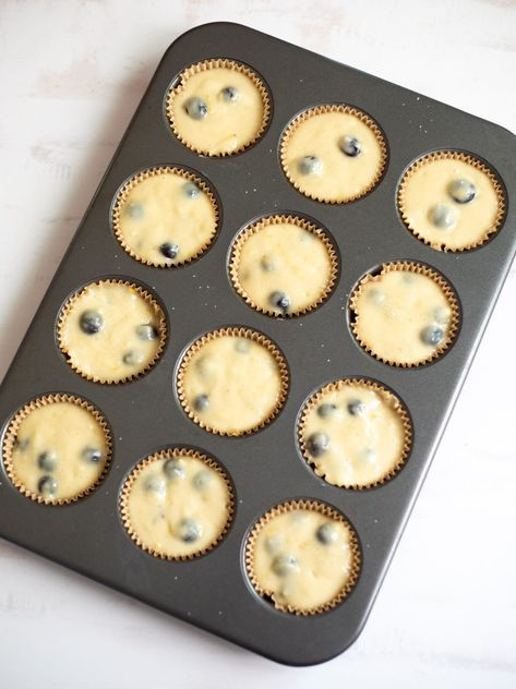 Warm, homeade Lemon Blueberry Muffins make the perfect lunchbox treat or snack. Fresh blueberries mixed with a hint of lemon make these muffins naturally sweet! | Healthy Muffin Recipe | #breakfastrecipe #bakingwithkids #blueberrymuffins | pipingpotcurry.com