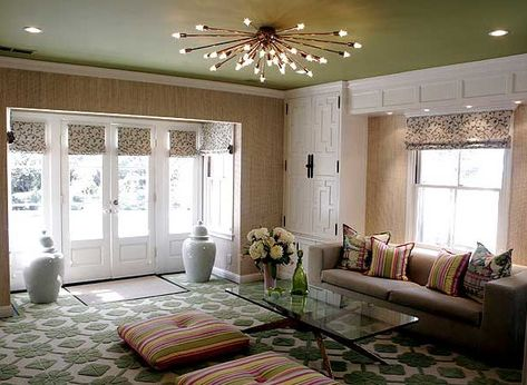 Love how so many different patterns created such a cohesive look. Great statement light for a low ceiling.