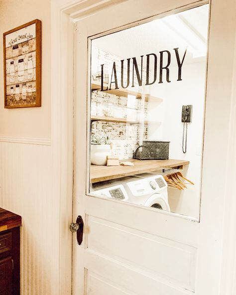 Chippy laundry room doors are my favorite! Head over to @itty_bitty_farmhouse on IG for views of this look.