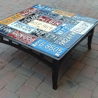 Coffee Table - To easy, I just attached a collection of old license plates and gave them several clear coats to protect them from skills. What's nice is you can ad your favorites to it.
