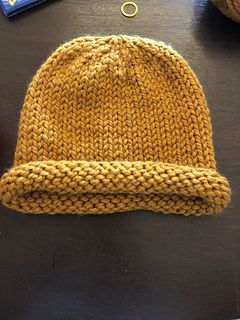 This Rolled Brim Hat Knitted In The Round With Super Bulky Yarn Is A Great Project For A Confident Begi Hat Knitting Patterns Knitted Hats Baby Hats Knitting