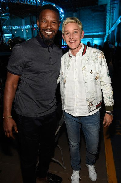 Actor Jamie Foxx and tv personality Ellen DeGeneres pose backstage during 'One Voice: Somos Live! A Concert For Disaster Relief.'