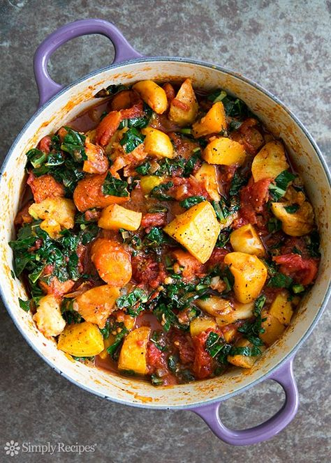 A ragout of roasted root vegetables—parsnips, carrots, beets, rutabagas—with tomatoes and kale.