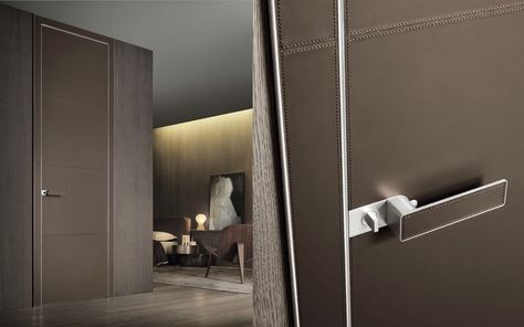 The Luxor door from Pure Interiors by Rimadesio   The co-planar door panels are custom made with a slender aluminium structure and a push/pull opening, characterised by its exclusive lacquered glass jamb which offers complete integration between the wall and door panel (shown here in leather).