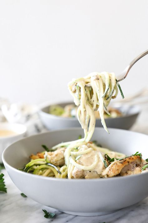 Creamy, dairy-free and healthy comfort food, this Paleo + Whole30 creamy chicken alfredo is an easy, weeknight dinner the whole family will love! The cashew cream sauce is velvety and delicious, with a cheesy flavor from nutritional yeast. Enjoy this quick and easy meal! | realsimplegood.com #paleo #whole30 #comfortfood #dairyfree #zoodles