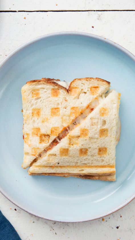 Recipe with video instructions: Put your waffle iron to good use with slices of sourdough sandwiching chicken tenders, mozzarella and marinara. Ingredients: 8 slices sourdough bread, 2...