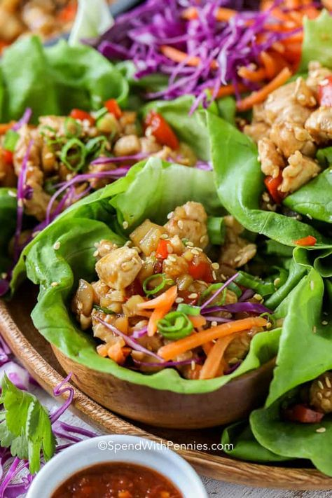 Asian chicken lettuce wraps are a fun and healthy appetizer to serve your guests! Chicken, bell peppers and green onions are tossed in an easy homemade Thai sauce that rivals PF Changs recipe for flavor! #spendwithpennies #lettucewraps #asianinspired #appetizer #healthyrecipes