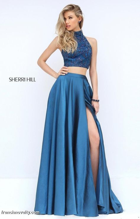 f9c2ed19271 Sherri Hill 50627 is a two-piece ball gown with a high neckline and slit  skirt.