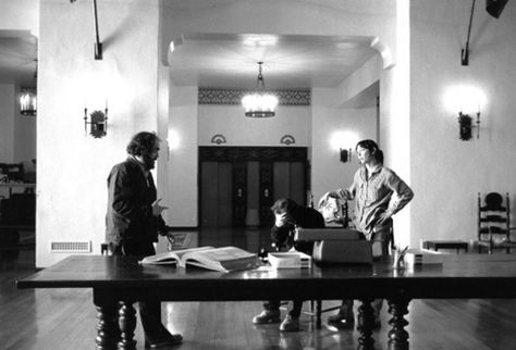 Director Stanley Kubrick rehearses a scene with actors Jack Nicholson and Shelley Duvall on the Colorado Lounge set of The Shining.