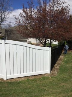 Beautiful Combination Of Fence Styles White Semi Privacy Vinyl Fence With Black Caps And Black Ornamental Aluminum Triboro Fence Styles Backyard Vinyl Fence