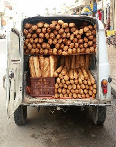 One of my favorite things living France- fresh hot baguettes sold out of the back of a car and delivered daily.  The little town I lived in the baker would make his rounds on a bicycle with the baguettes in a basket tied to the handle bars