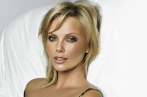 I love Charlize Theron's makeup in this photo. Slightly bronzed, smokey eyes, just-pinched cheeks