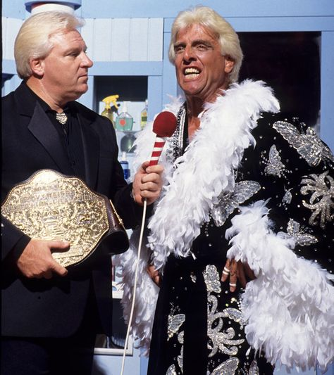 Ric Flair and Bobby Heenan with the World Heavyweight Title back in the day on WWF TV.