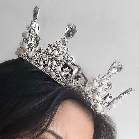 """Feel like the Queen that you are! Clear crystals, white opal, ivory tone Dimensions: Height 2.5"""" (highest point) Diameter 5"""" Styling Tip: Has been worn for Quinceañera, Brides, Sweet 16, Prom and/or themed parties"""